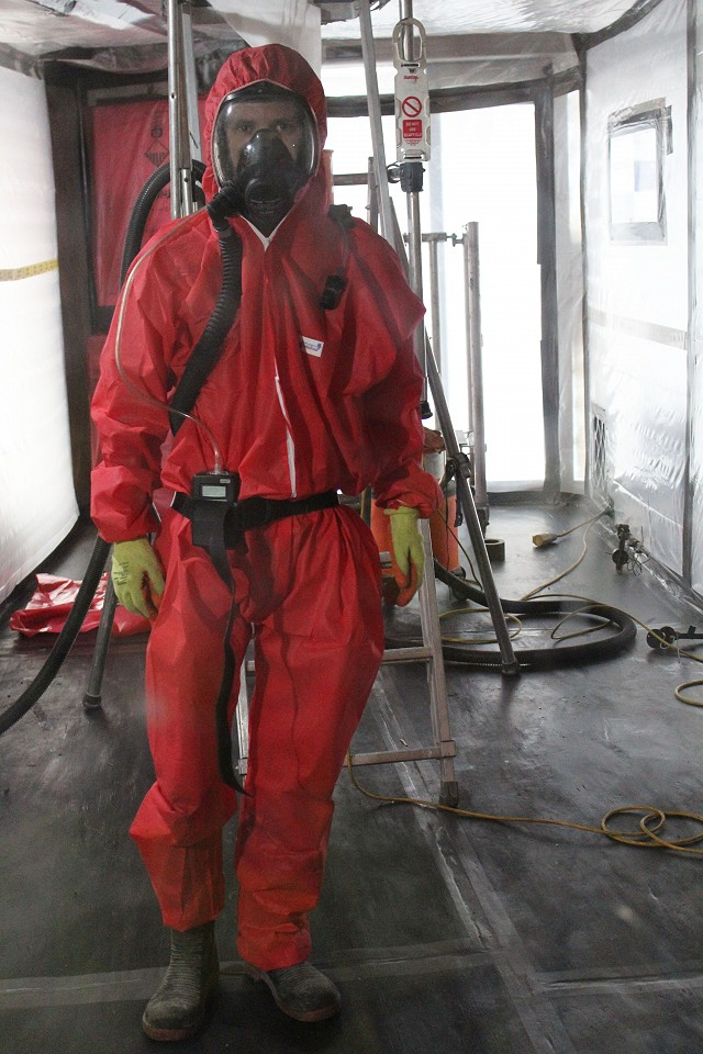 Asbestos operatives inside carrying out a personal air monitoring test