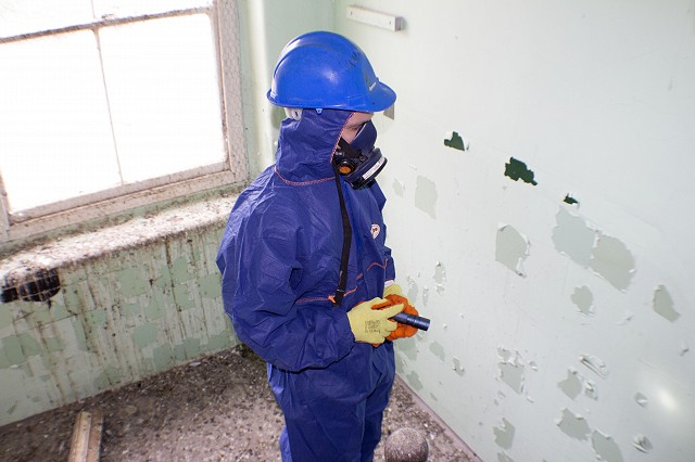 Asbestos operative inspecting pigeon guano 2